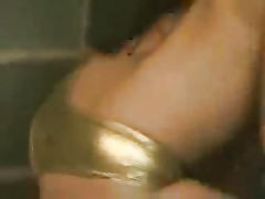Super sexy honey in shiny gold mini dancing her gazoo off